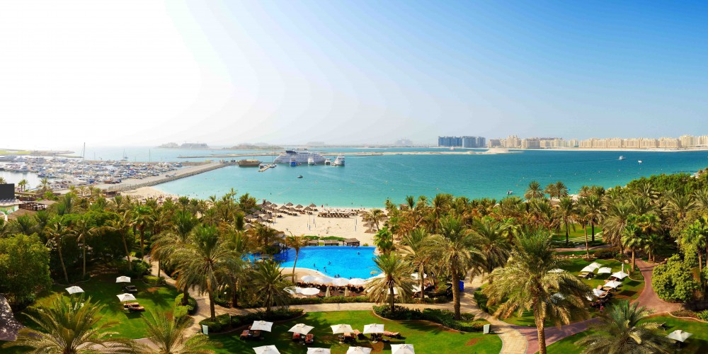 Panorama of beach with a view on Jumeirah Palm man-made island, Dubai, UAE